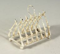 A SILVER PLATE TOAST RACK, CROSS RIFLES