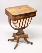 A REGENCY ROSEWOOD SEWING TABLE, with reversible Backgammon top , sliding drawer and sewing bag on