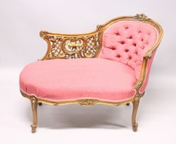 A VICTORIAN MAHOGANY PIERCED AND GILDED CHAISE LOUNGE, with button back and padded seat on