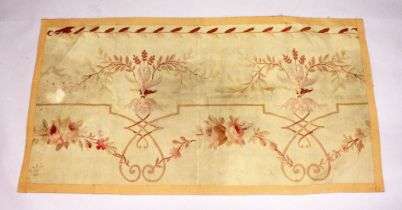 AN AUBUSSON PIECE OF TURKISH FABRIC with roses and scrolls 5ft x 2ft 9ins