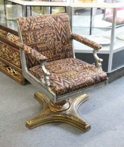 A HIGHLY ORNATE CAST AND POLISHED STEEL AND BRASS REVOLVING ARMCHAIR, possible originally a barber's