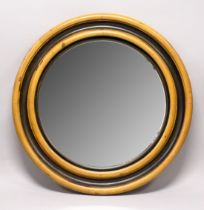 A GOOD LARGE 20TH CENTURY CIRCULAR STAINED PINE MIRROR, with moulded frame. 4ft diameter.