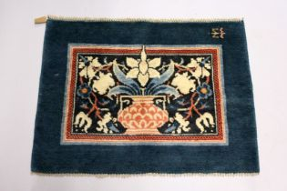 MORRIS & CO., HAMMERSMITH STUDIO, a small wool rug, blue ground, the central rectangular panel woven