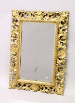 A GOOD 19TH CENTURY FLORENTINE GILT FRAMED RECTANGULAR MIRROR, the frame with well carved leaf and