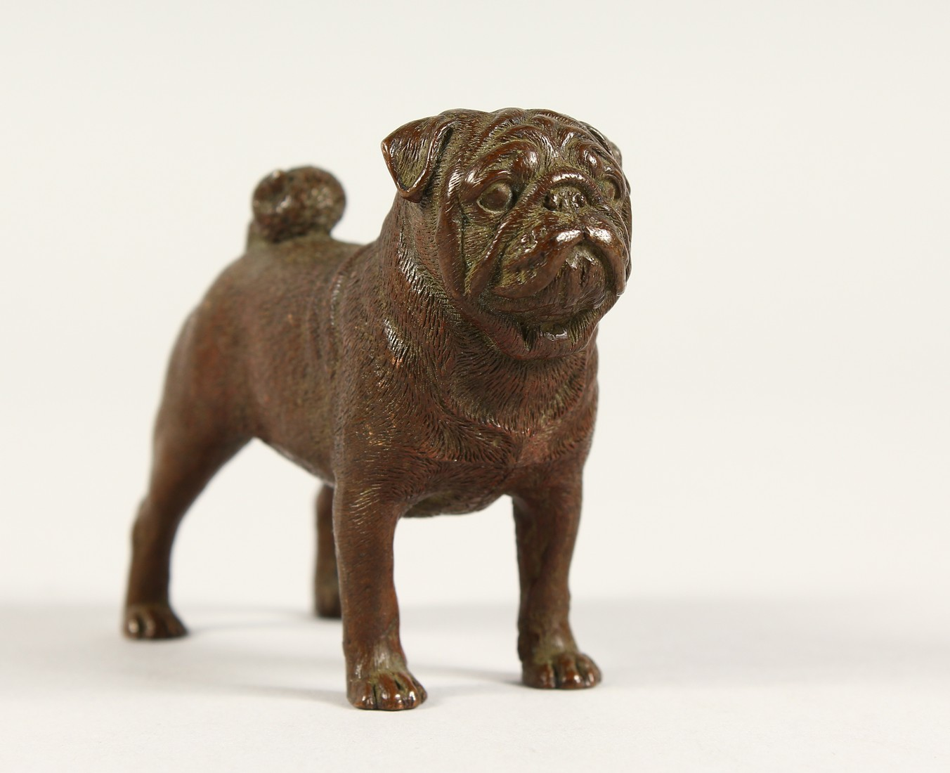 A SMALL HEAVY BRONZE PUG DOG 3ins long