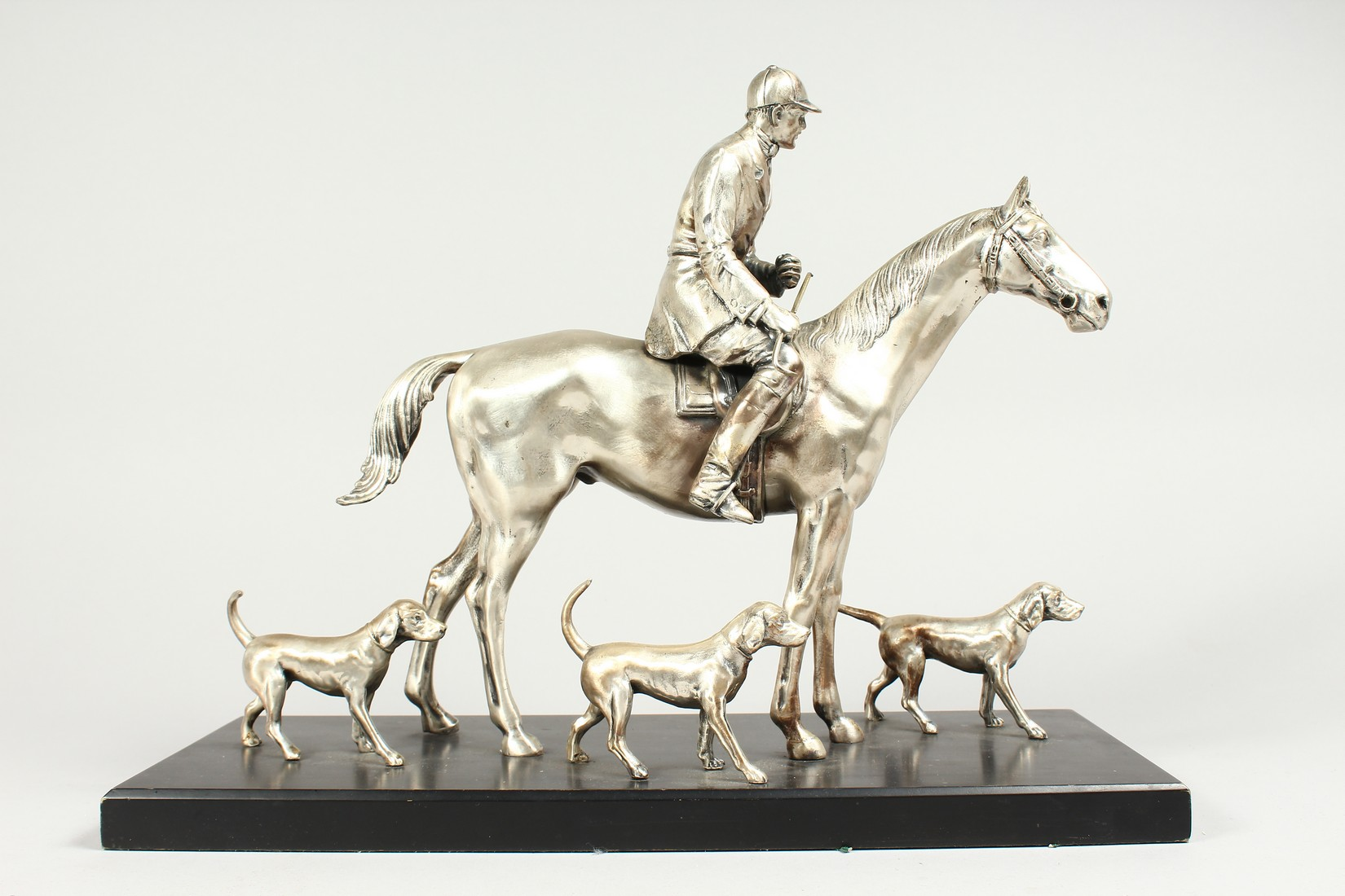 A SILVERED BRONZE GROUP HORSE AND RIDER, with their dogs, on a wooden base. 17ins long, 12ins high. - Image 6 of 10