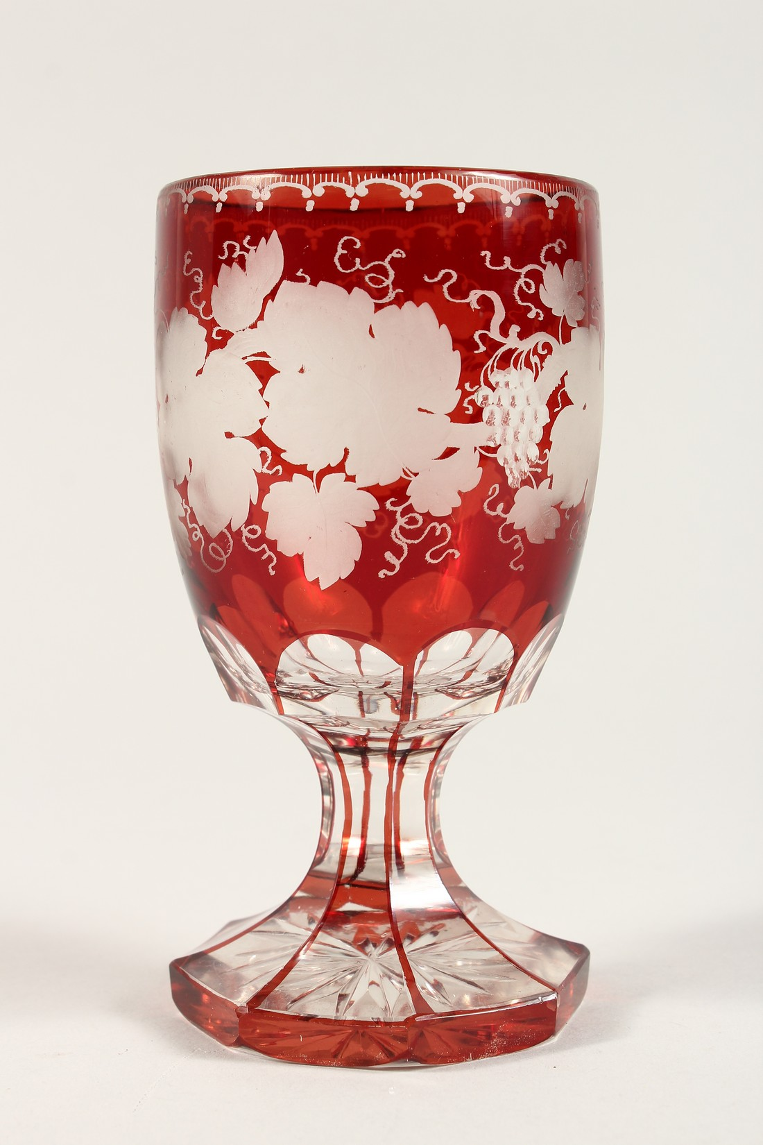 A GOOD BOHEMIAN RUBY GLASS GOBLET ethched with fruiting vines on an octagonal base. 6ins high. - Image 2 of 5
