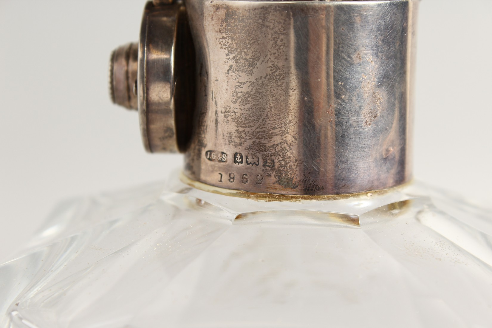 A HEAVY SQUARE GLASS WHISKY DECANTER AND STOPPER with silver band. - Image 3 of 3