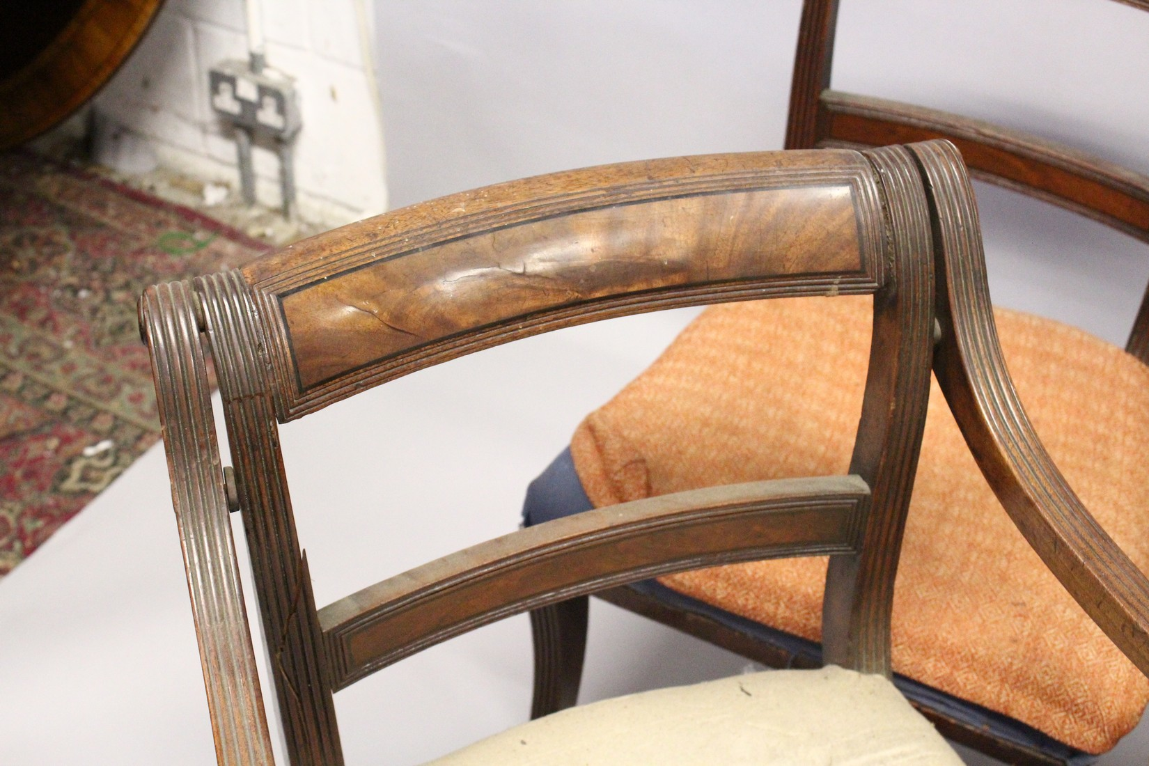 A PAIR OF MAHOGANY, SABRE LEG ARM CHAIRS and three matching single chairs. - Image 3 of 5