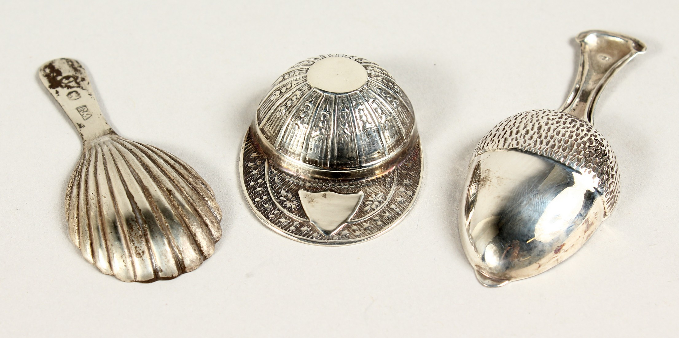 TWO SILVER CADDY SPOONS, JOCKEY CAP AND ACORN.