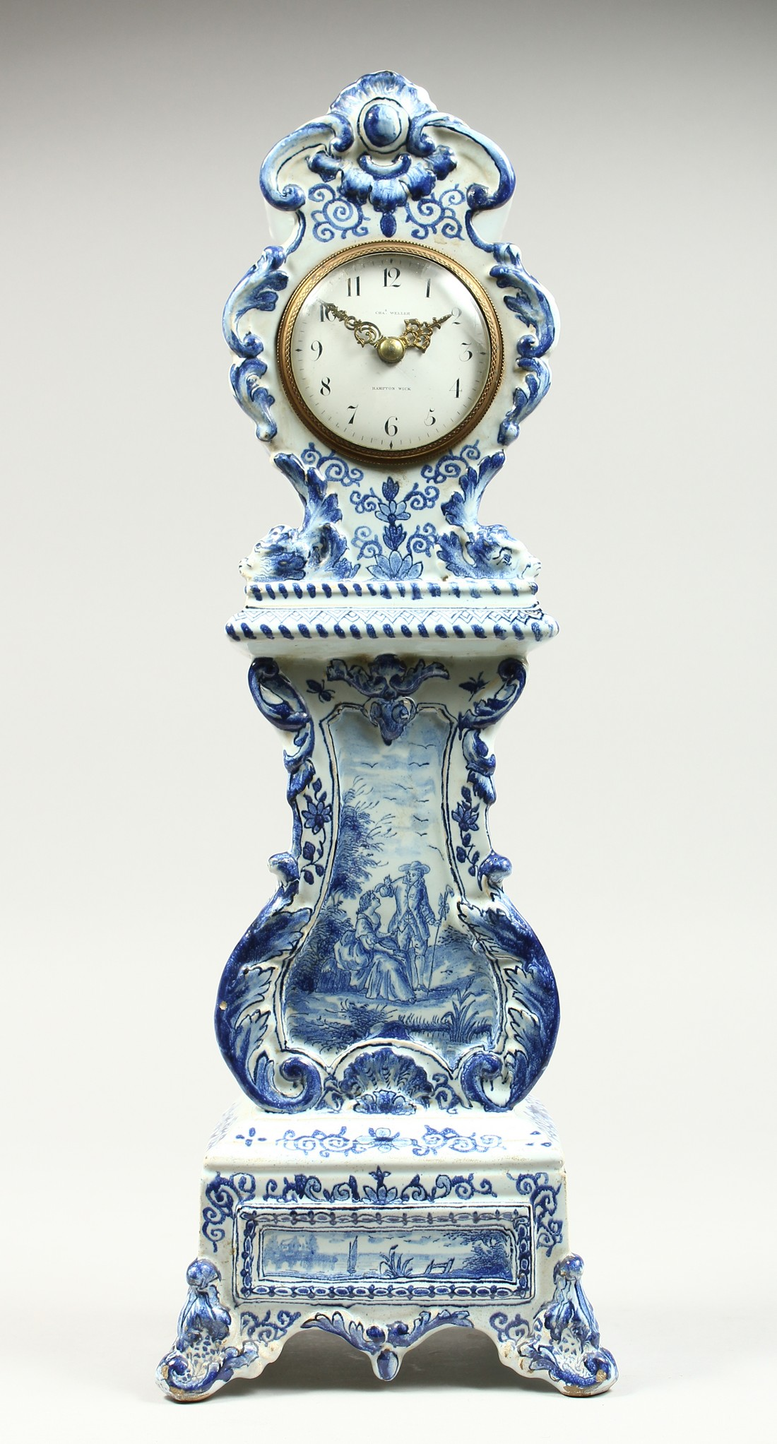 A 19TH CENTURY DUTCH BLUE AND WHITE MINIATURE PORCELAIN LONGCASE CLOCK, the movement by Charles