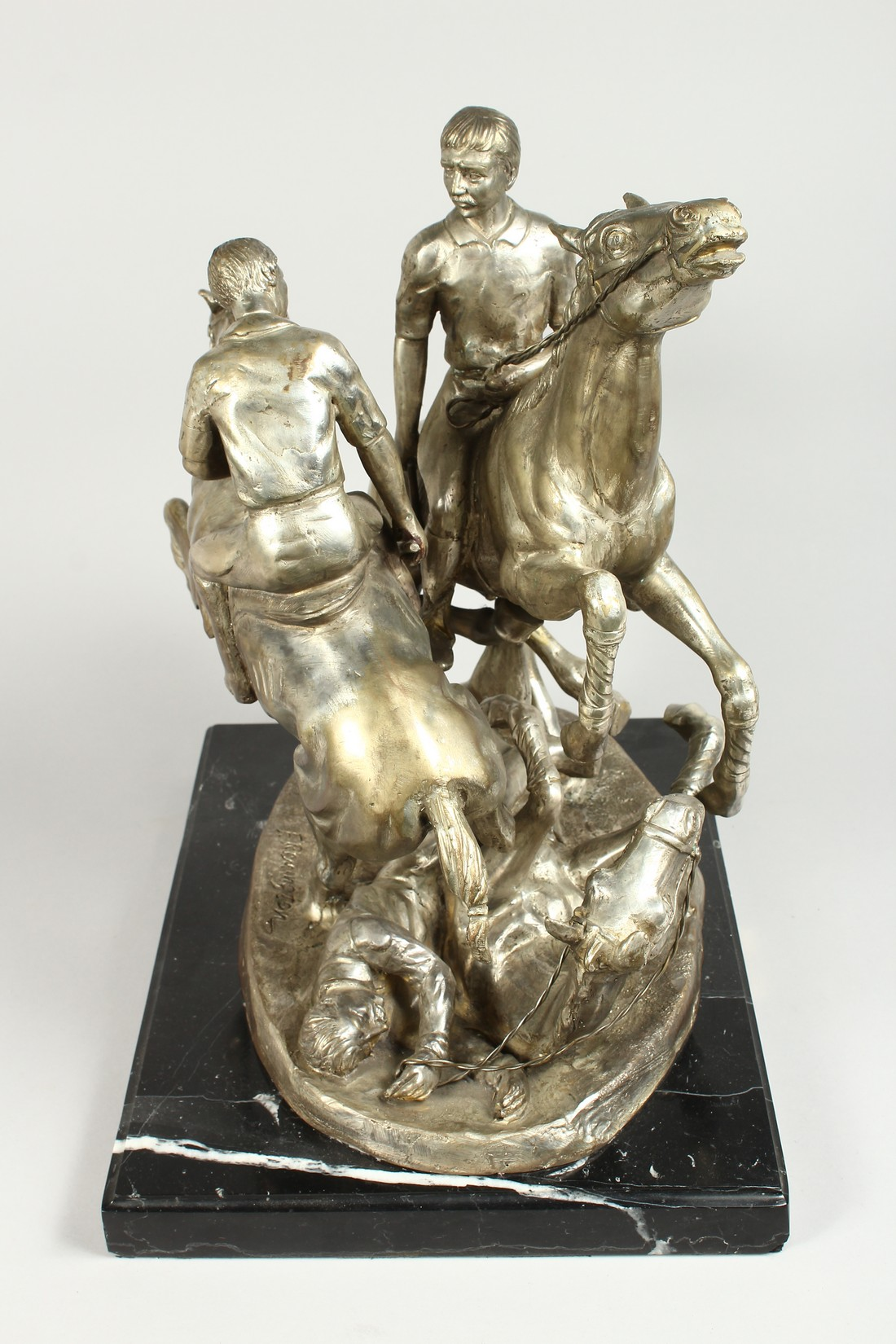 AFTER F. REMMINGTON A SILVER BRONZE GROUP OF TWO RIDERS ON HORSEBACK, a horn and rider on the floor. - Image 10 of 16