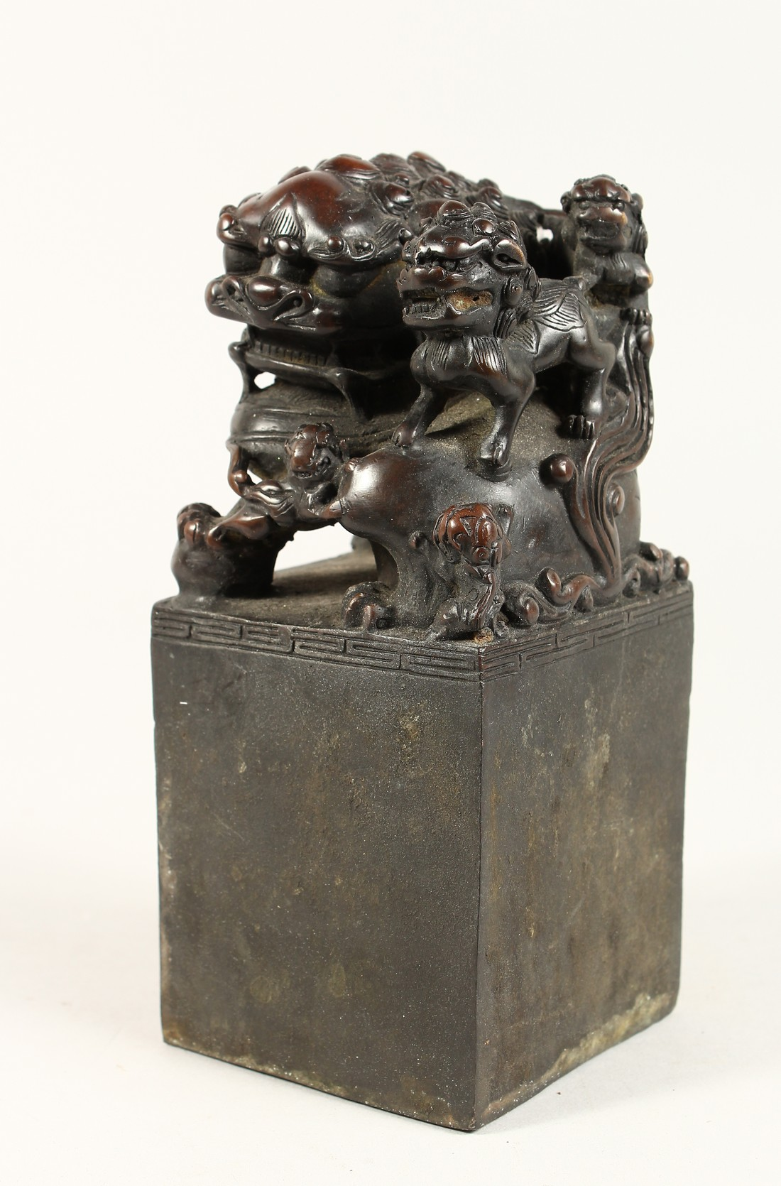 A CHINESE BRONZE DOG OF FO SQUARE SEAL 7.5ins high.