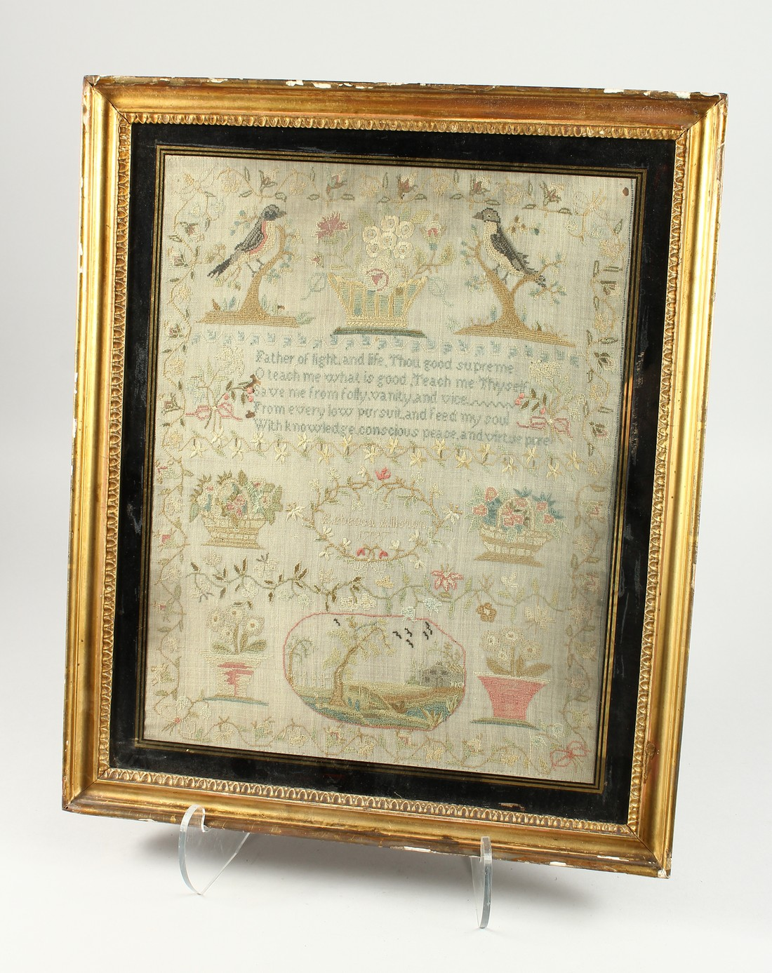 A GEORGE III FRAMED AND GLAZED SAMPLER by Roberta Allerton, 1787, with a poem, birds, flowers etc.
