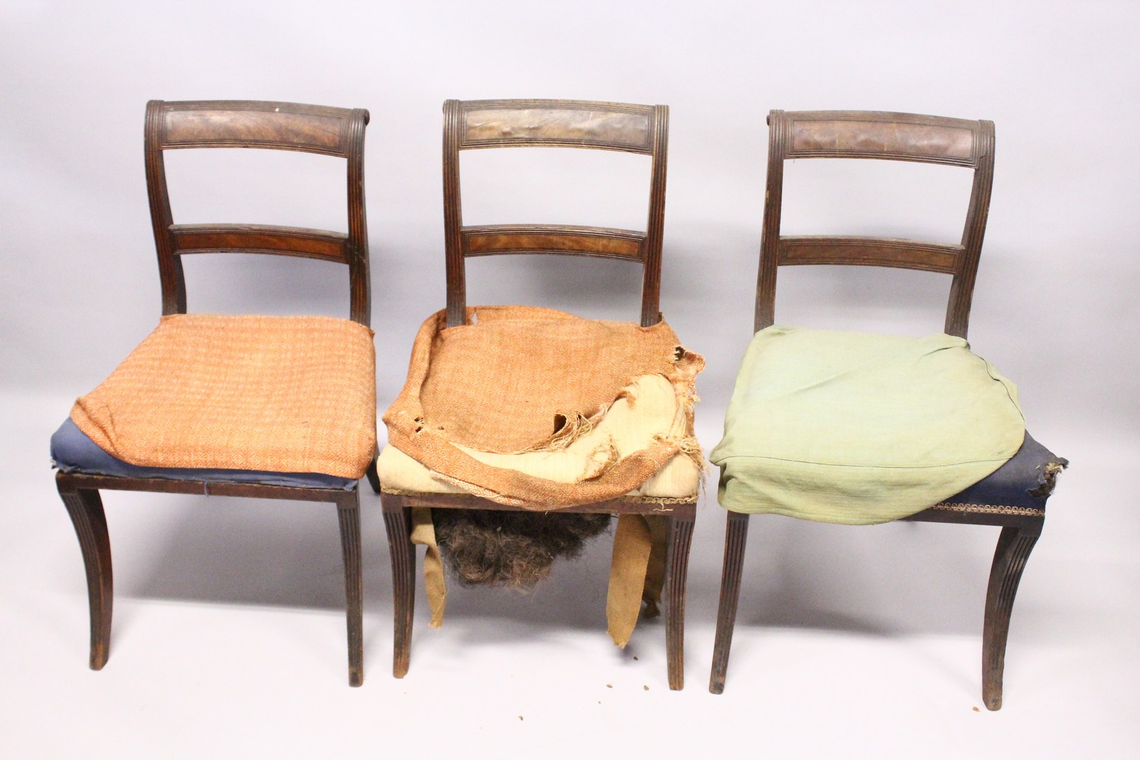 A PAIR OF MAHOGANY, SABRE LEG ARM CHAIRS and three matching single chairs. - Image 5 of 5