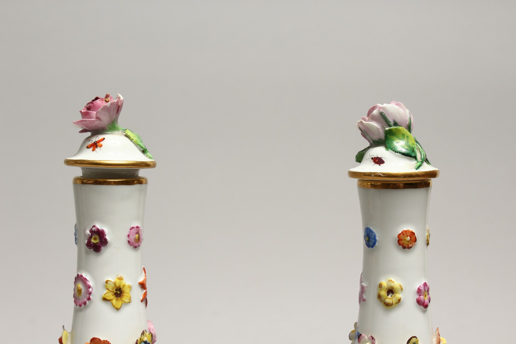A GOOD PAIR OF MEISSEN FLOWER AND FRUIT ENCRUSTED VASES AND COVERS. Cross swords mark in blue. 10. - Image 7 of 8