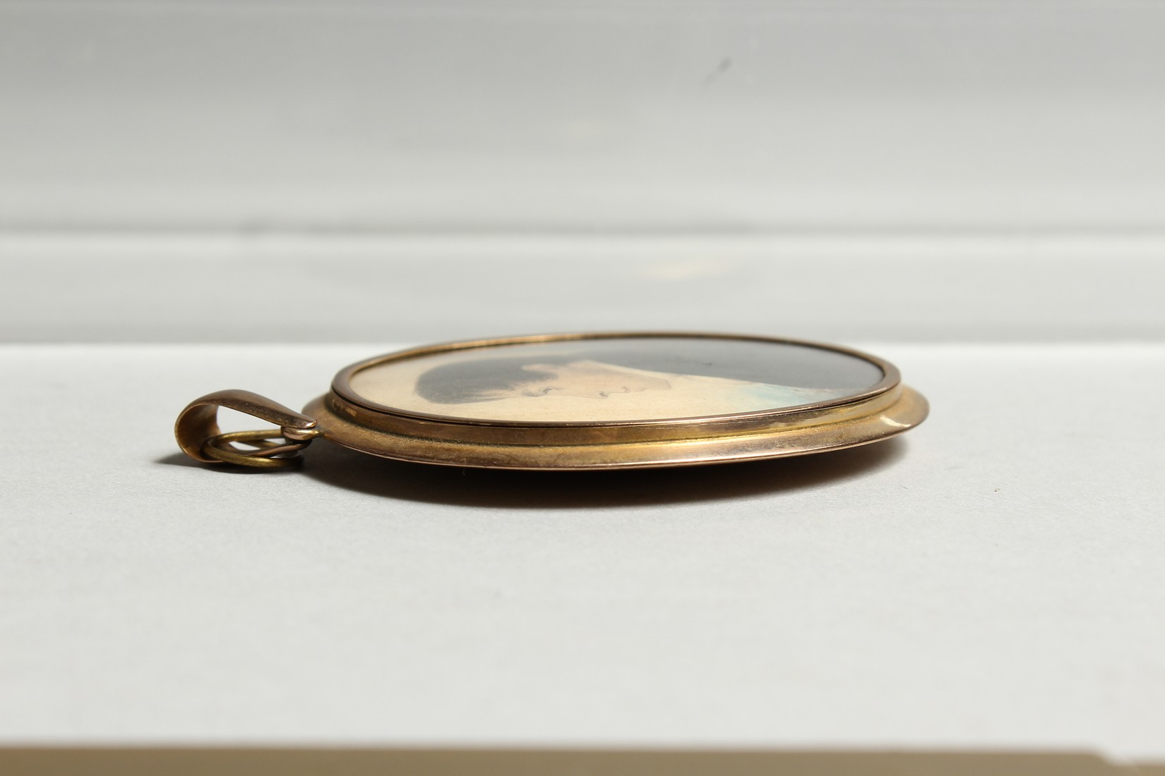 AN EARLY VICTORIAN OVAL MINIATURE OF A GENTLEMAN in a gilt frame. 2.25ins x 1.75ins - Image 6 of 7