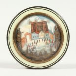 A GEORGIAN TORTOISESHELL CIRCULAR BOX, the top painted with buildings. 3.25INS