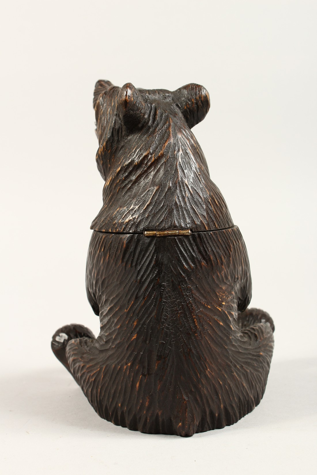 A BLACK FOREST CARVED WOOD BEAR CADDY. 8ins high. - Image 3 of 4