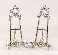 A PAIR OF MEDIUM SILVERED EASELS 1ft 4ins high
