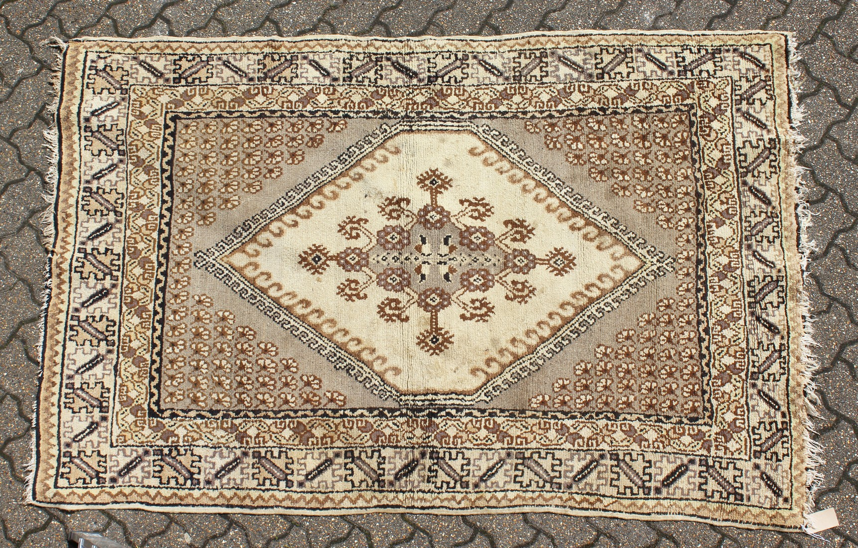 A PERSIAN RUG brown and cream with large medallions. 6ft 6ins long x 4ft 6ins wide