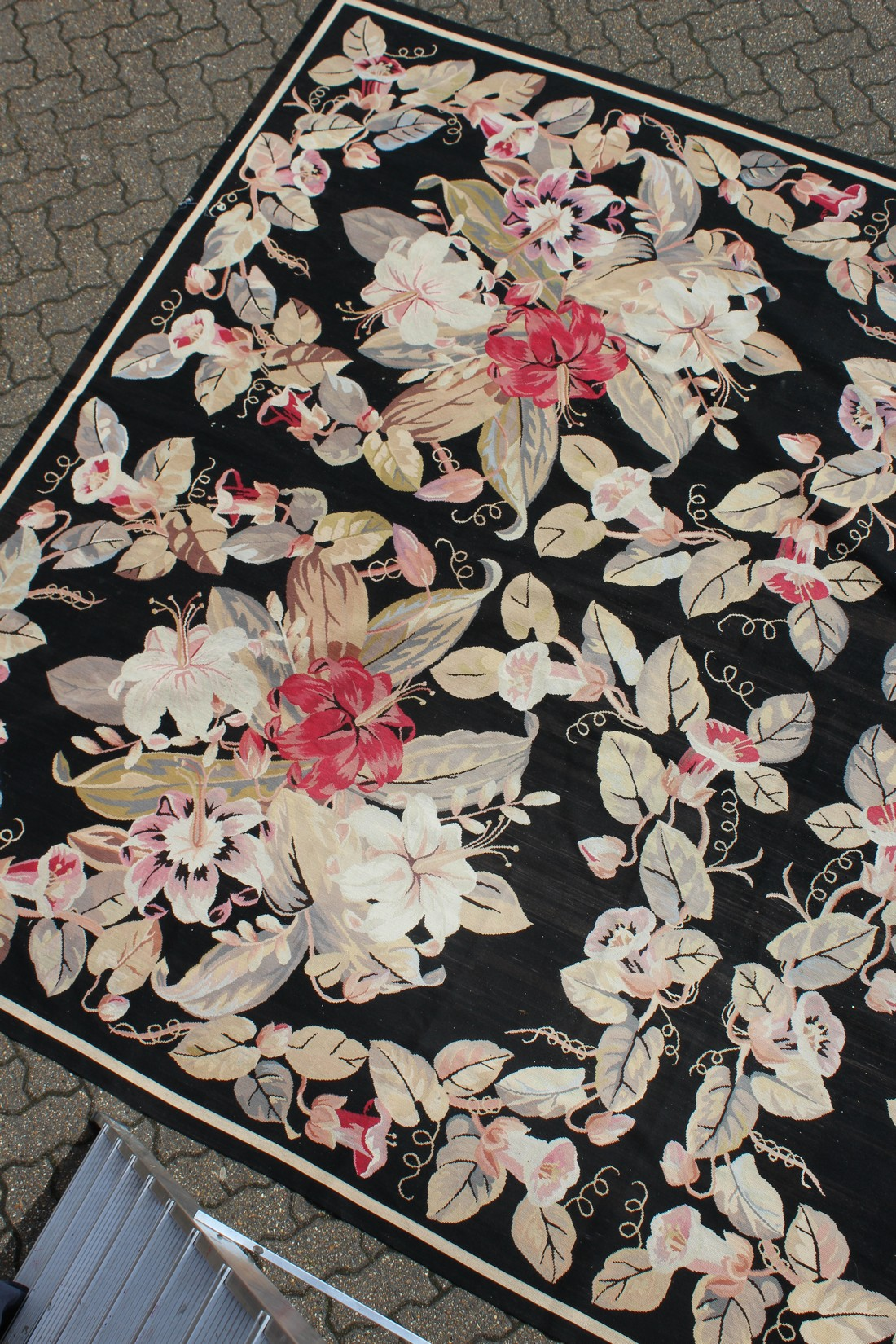A LARGE ABUSSON STYLE TAPESTRY WALL HANGING, black ground, with floral decoration. 14ft 2ins x - Image 3 of 4