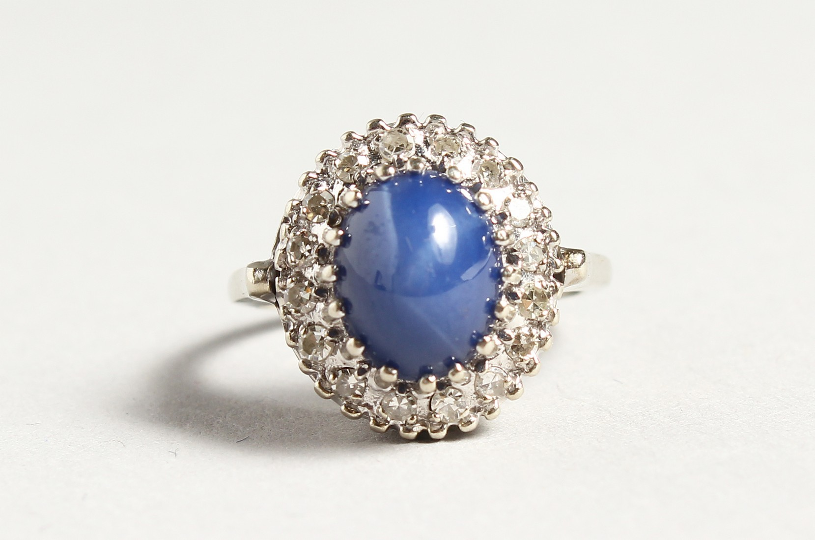 A GOLD CARBOUCHON SAPPHIRE AND DIAMOND RING