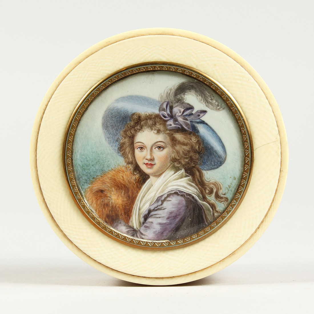 A GEORGIAN IVORY CIRCULAR BOX, the top painted with a portrait of a young lady in a plumed hat. 3ins