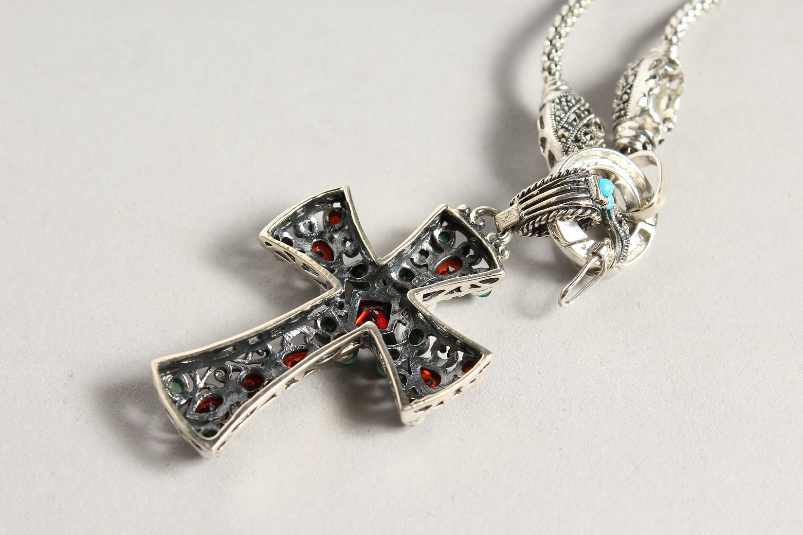 A SILVER TURQUOISE AND GARNET CROSS on a silver chain. - Image 3 of 3