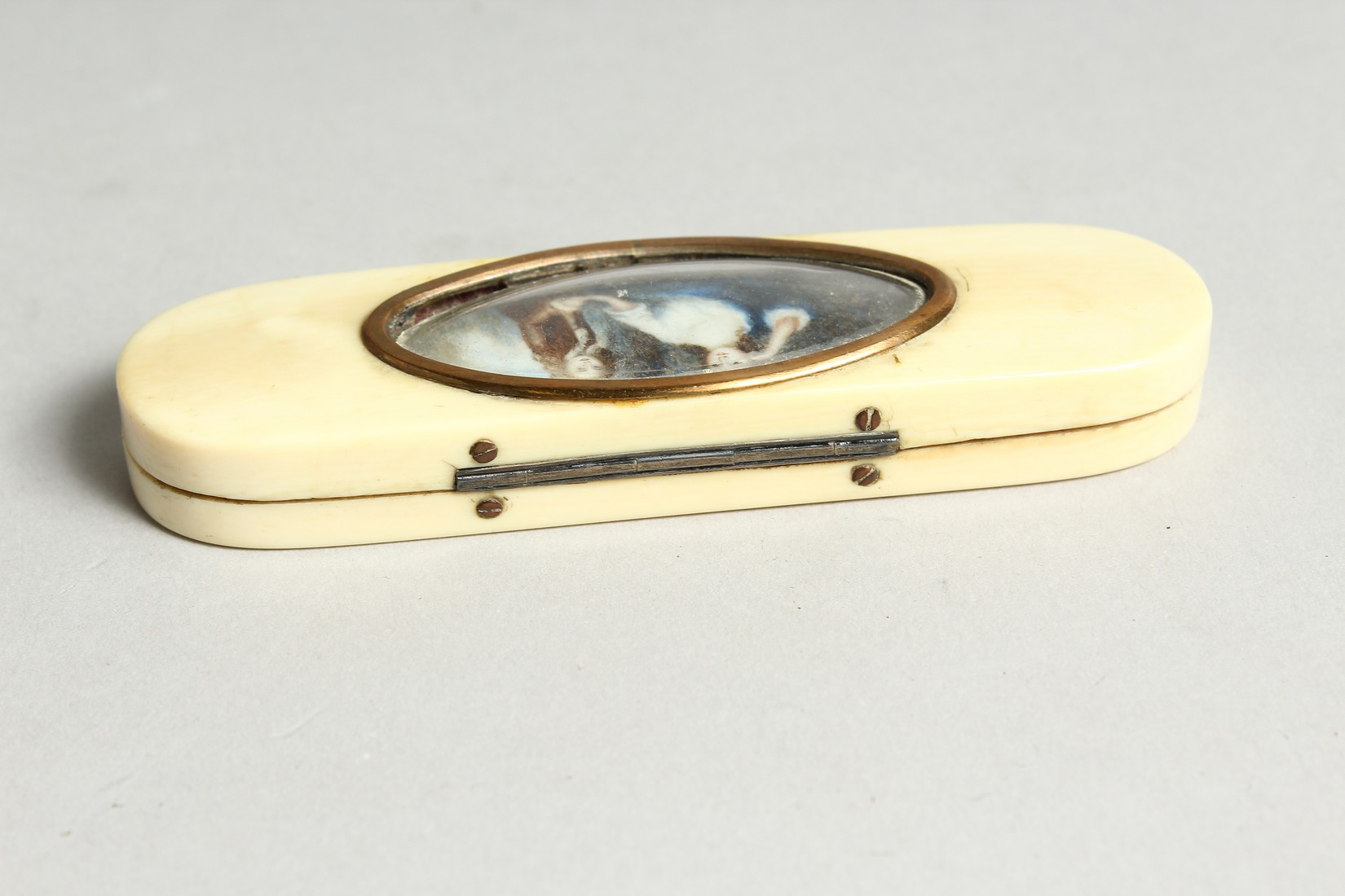 A GEORGIAN IVORY LONG PINBOX, the top with an oval, lady and young boy. 4ins long. - Image 4 of 6