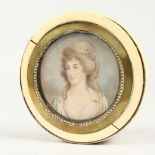 A GEORGIAN IVORY CIRCULAR BOX, the top painted with a portrait of Lady Mary Onslow. 3.75ins