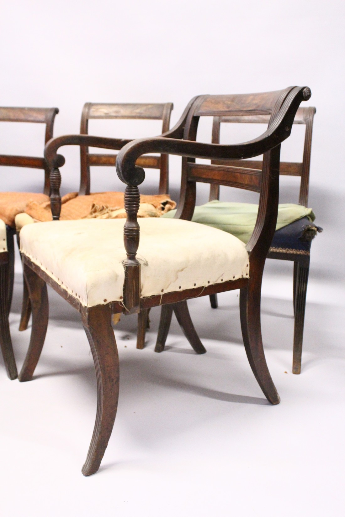 A PAIR OF MAHOGANY, SABRE LEG ARM CHAIRS and three matching single chairs. - Image 4 of 5
