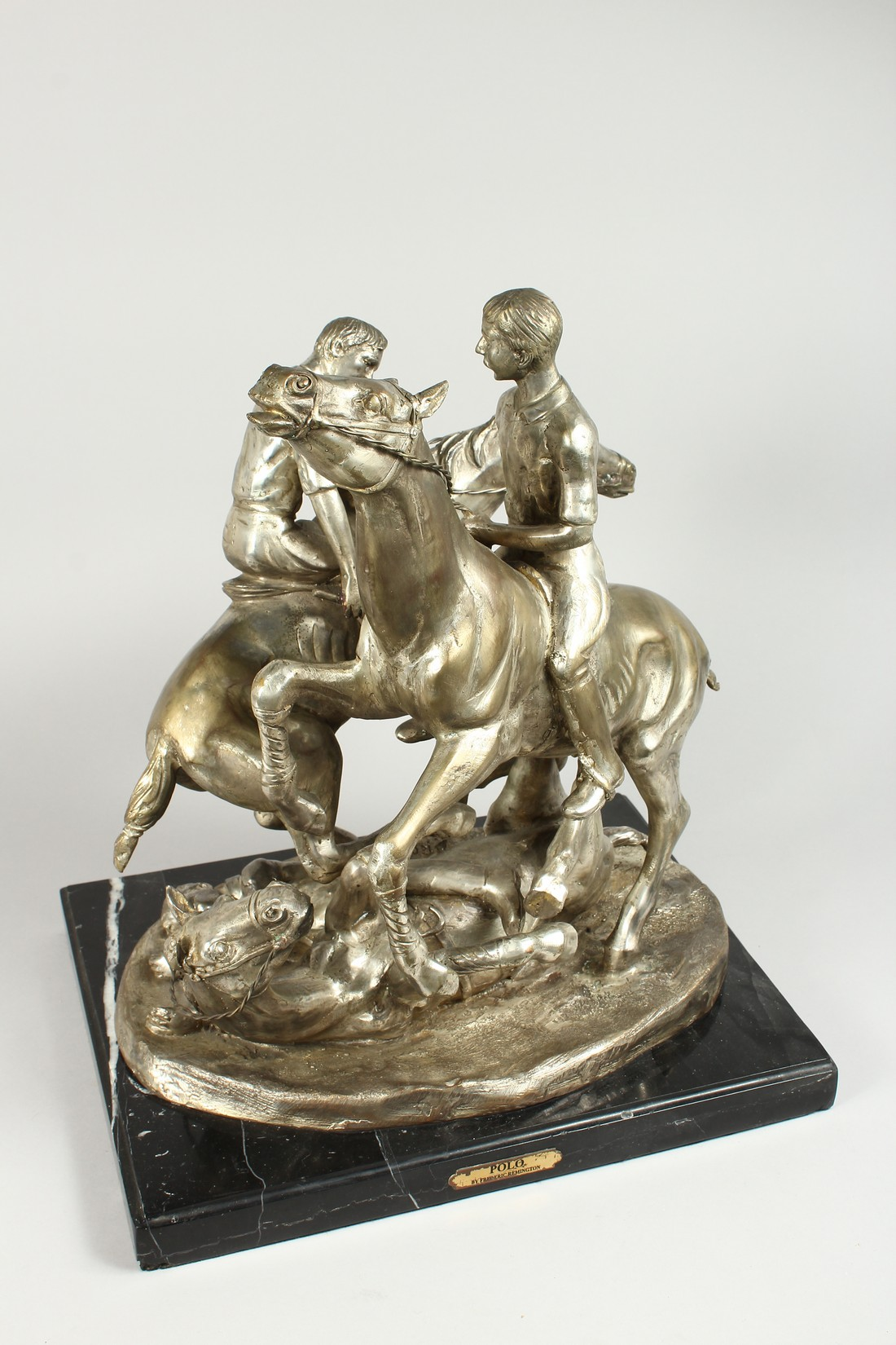 AFTER F. REMMINGTON A SILVER BRONZE GROUP OF TWO RIDERS ON HORSEBACK, a horn and rider on the floor. - Image 2 of 16