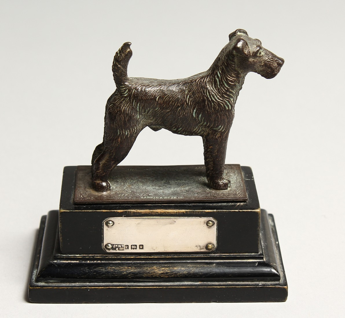 A FOX TERRIER with silver tablet. 2.5ins long