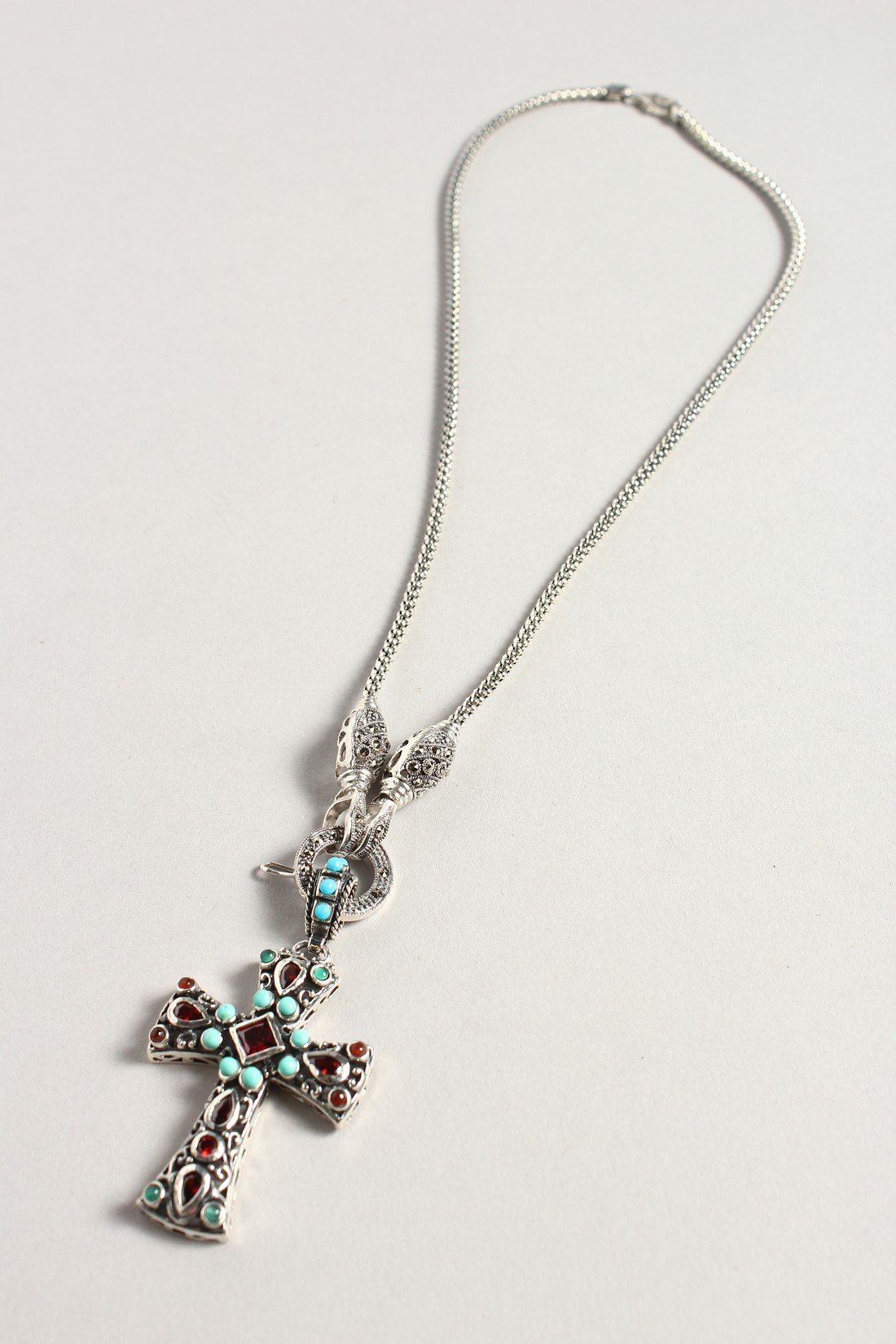 A SILVER TURQUOISE AND GARNET CROSS on a silver chain. - Image 2 of 3