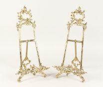 A PAIR OF LARGE BRASS EASELS 1ft 8ins high.