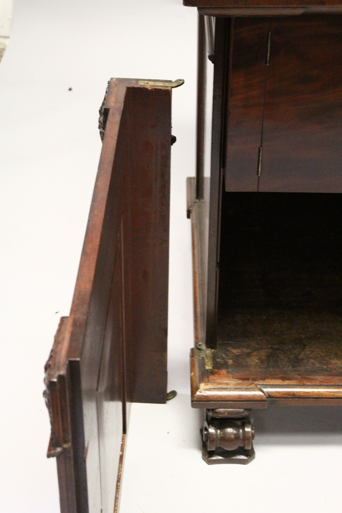 A GOOD 19TH CENTURY MAHOGANY PEDESTAL CUPBOARD, with a concave moulded top, panelled frieze with - Image 8 of 8