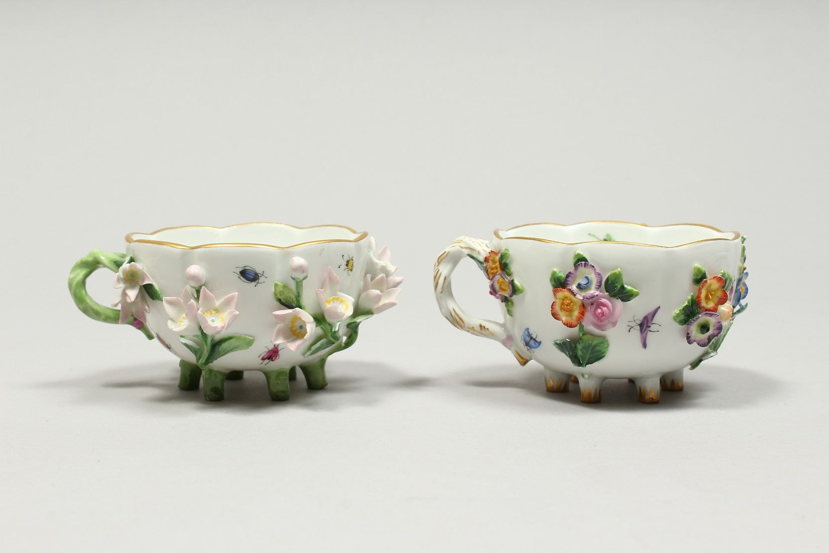 TWO MEISSEN PORCELAIN CUPS AND SAUCERS AND A SAUCER, encrusted with flowers and painted with - Image 2 of 16