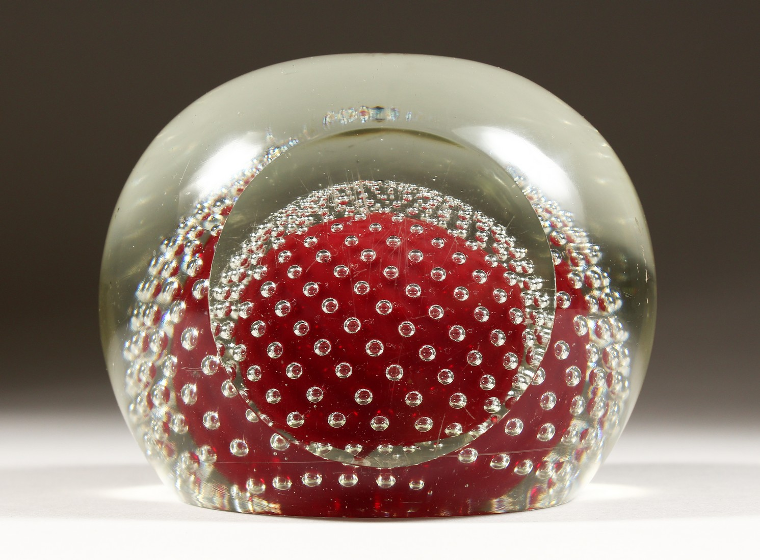 A LARGE GLASS PAPERWEIGHT.