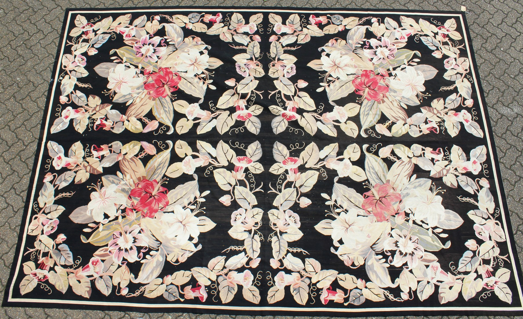 A LARGE ABUSSON STYLE TAPESTRY WALL HANGING, black ground, with floral decoration. 14ft 2ins x