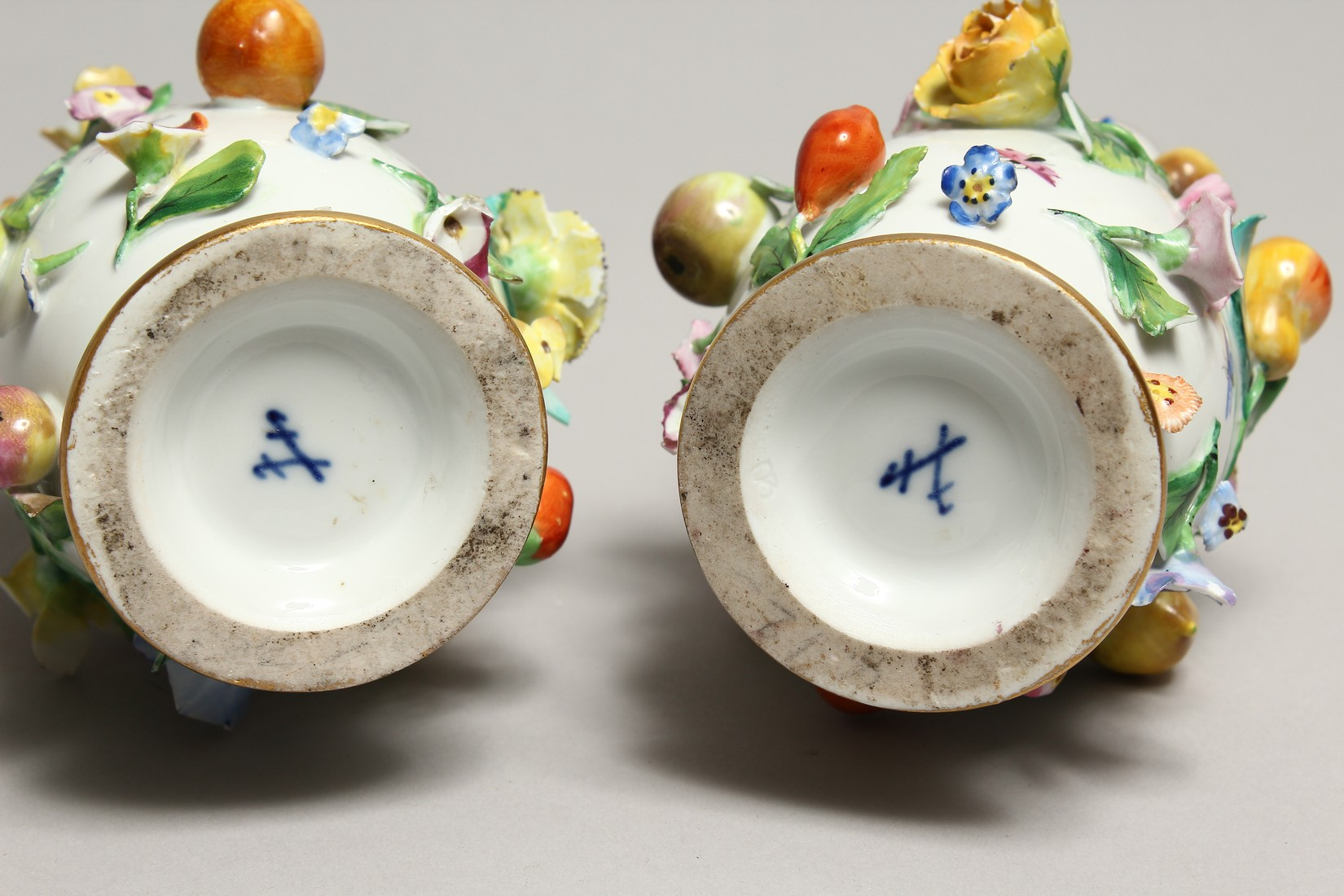 A GOOD PAIR OF MEISSEN FLOWER AND FRUIT ENCRUSTED VASES AND COVERS. Cross swords mark in blue. 10. - Image 8 of 8