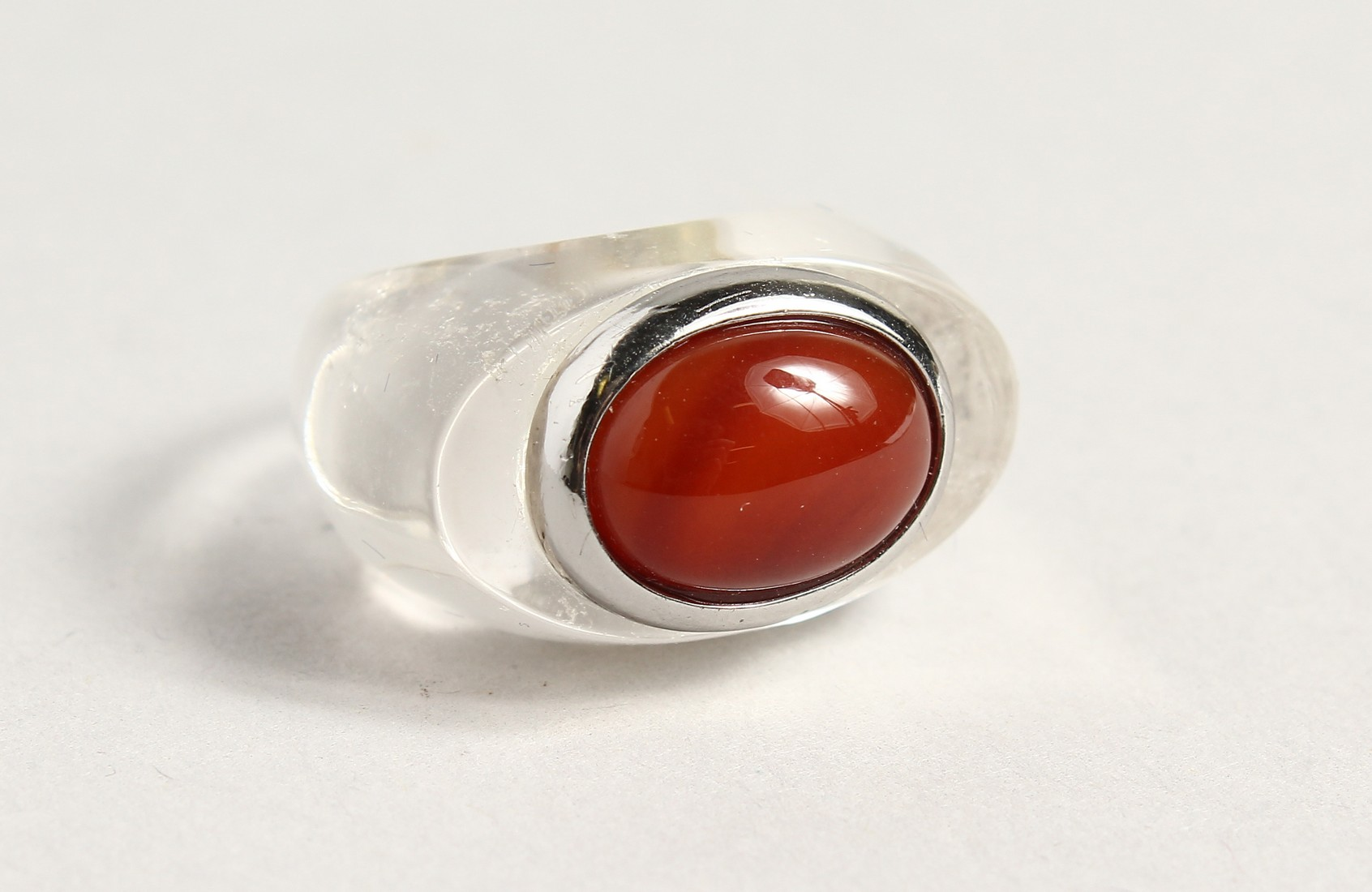 A RED STONE DESIGNER RING
