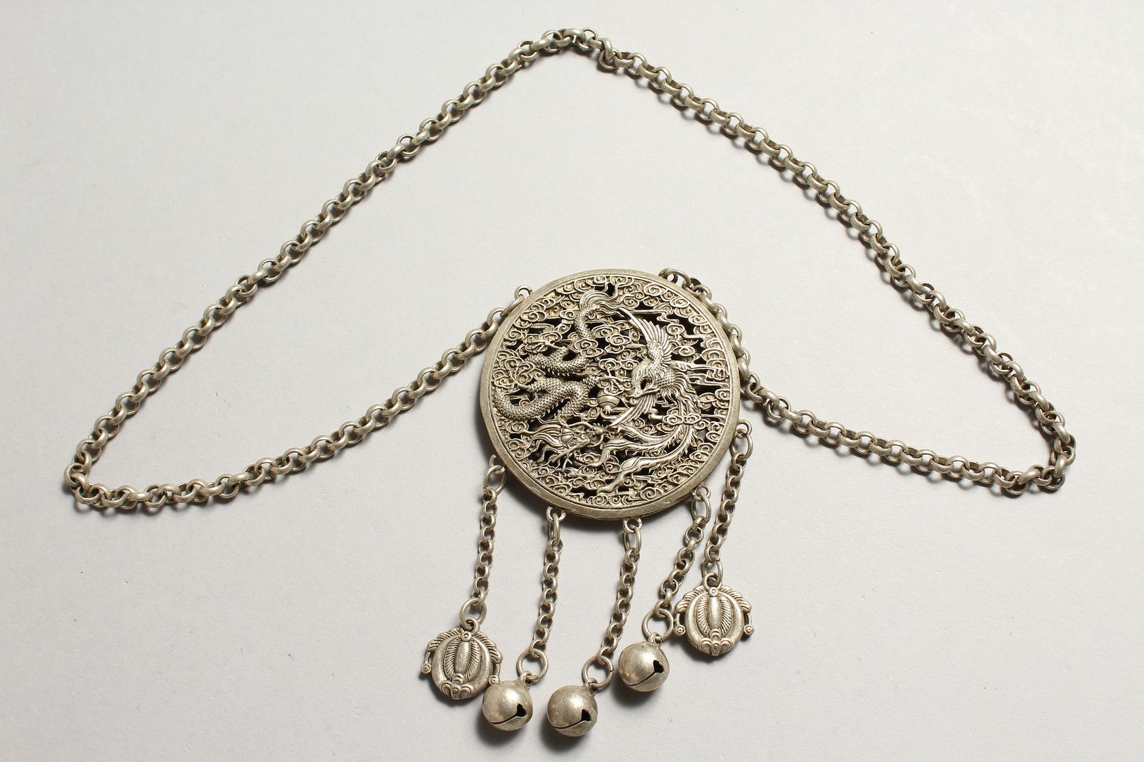 A CHINESE SILVER YIN-YANG PENDANT on a chain with dragon and phoenix. - Image 2 of 4