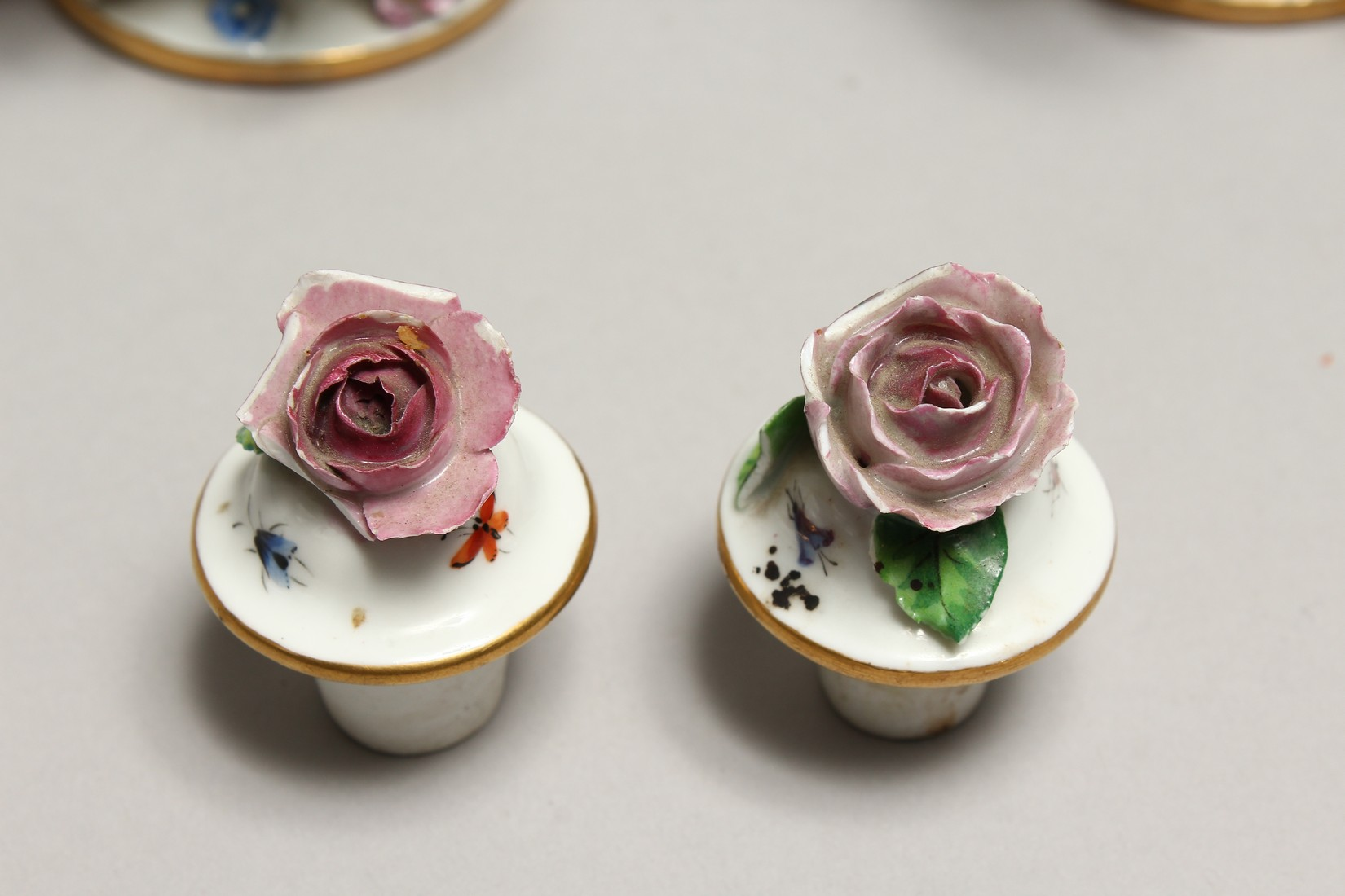 A GOOD PAIR OF MEISSEN FLOWER AND FRUIT ENCRUSTED VASES AND COVERS. Cross swords mark in blue. 10. - Image 5 of 8