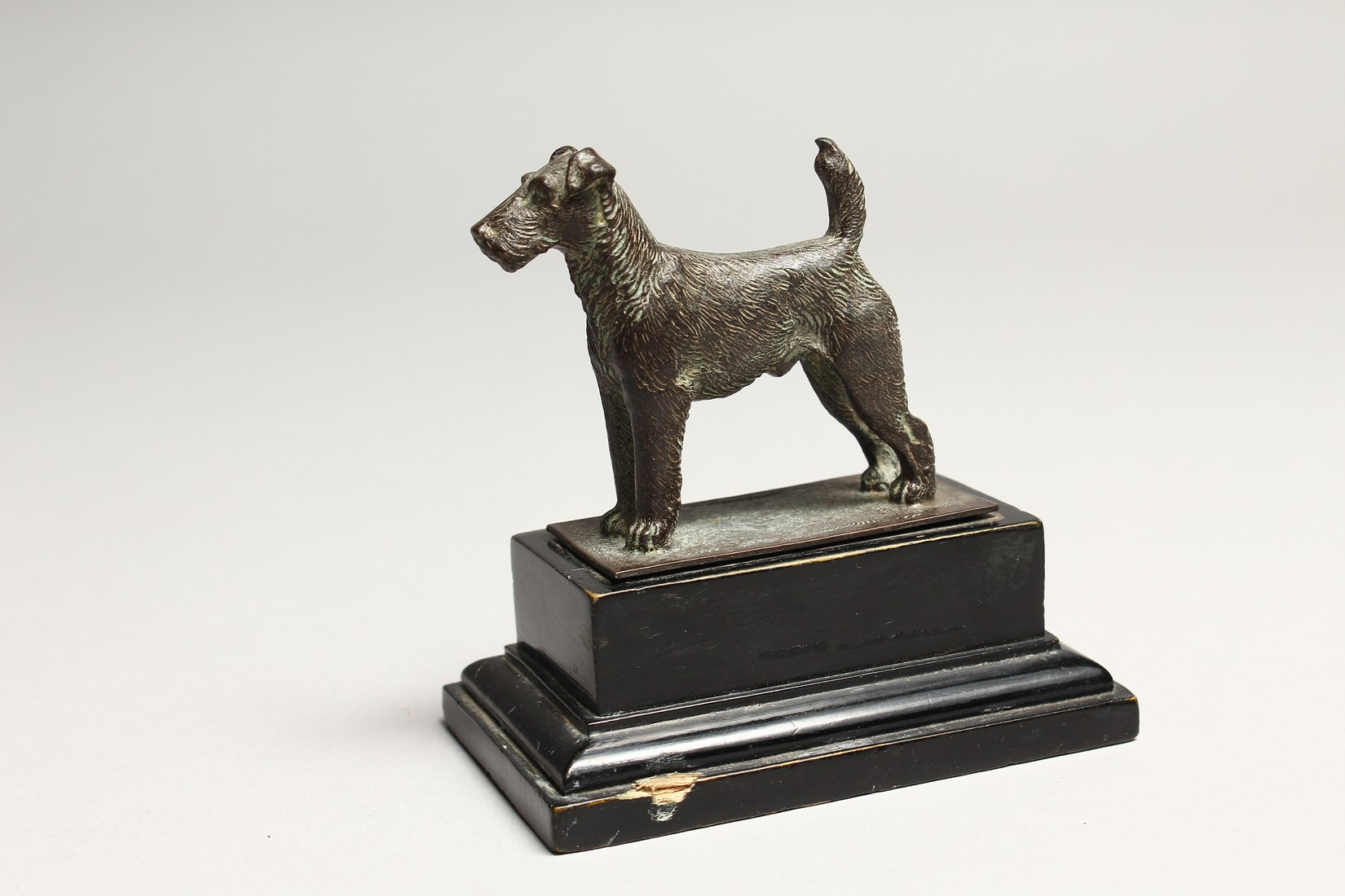 A FOX TERRIER with silver tablet. 2.5ins long - Image 4 of 5