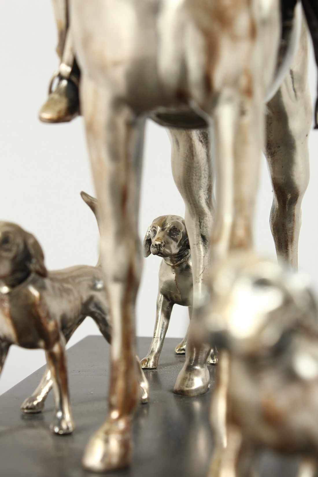 A SILVERED BRONZE GROUP HORSE AND RIDER, with their dogs, on a wooden base. 17ins long, 12ins high. - Image 4 of 10