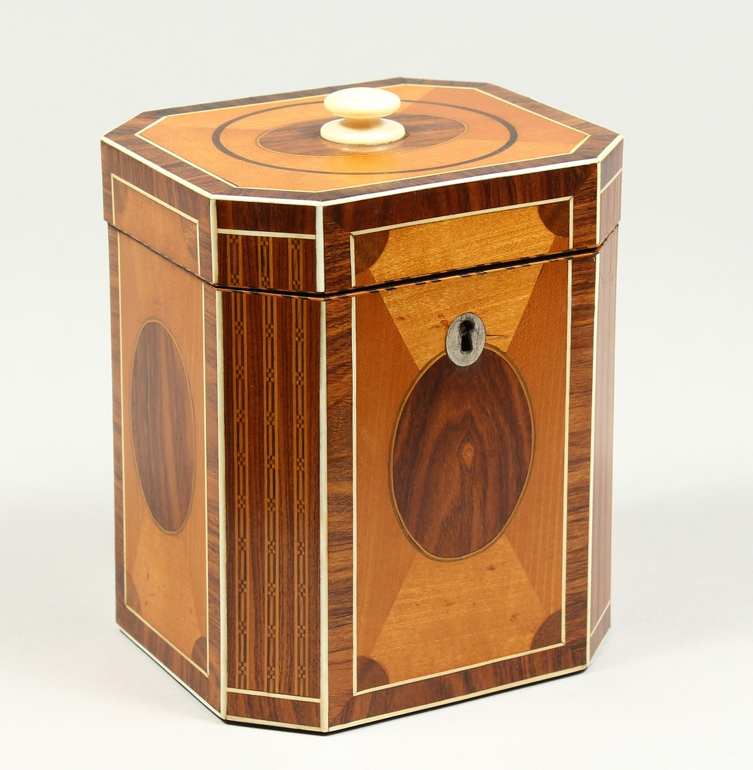 A SUPERB GEORGE III SATINWOOD BANDED TEA CADDY with rosewood and ivory canted corners and ivory