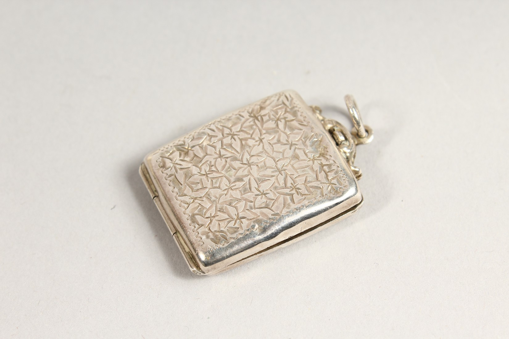 AN ENGRAVED SILVER STAMP HOLDER. - Image 2 of 3