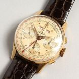 AN 18CT GUINAND 3 DIAL WRISTWATCH with leather strap. Possible a pilot's watch.