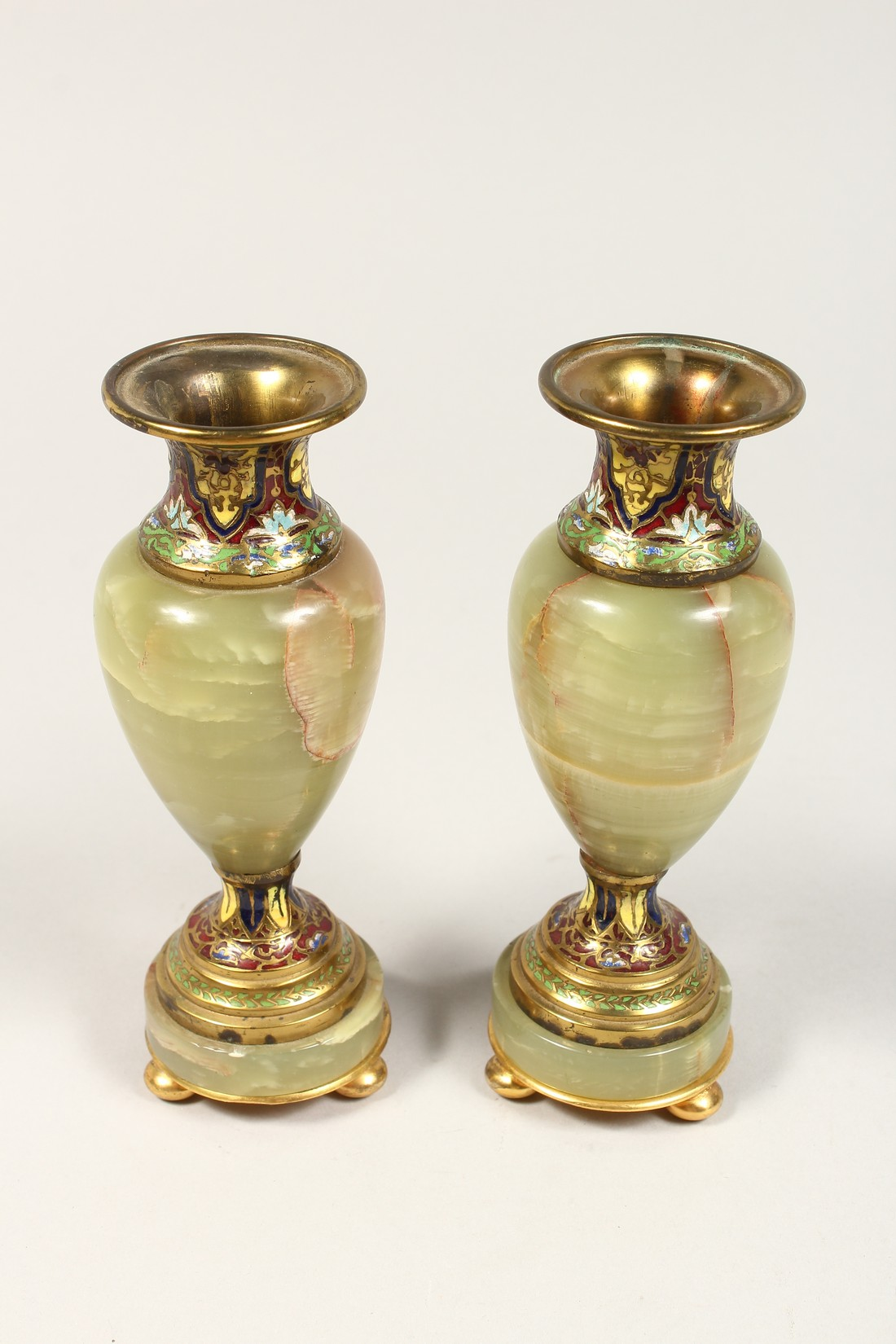 A GOOD SMALL PAIR OF FRENCH CHAMPAGNE ENAMEL AND ONYX VASES. 6.5ins high. - Image 2 of 5